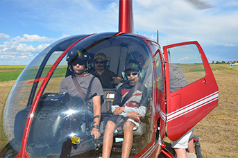 Familiarization Flights training - Students in a helicopter with their instructor.