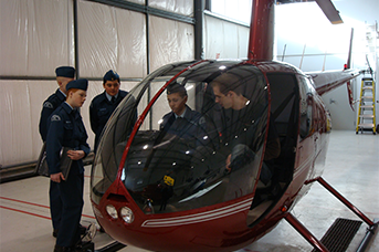 L R Helicopter Student Resources - Students with their instructors looking at a hilicopter