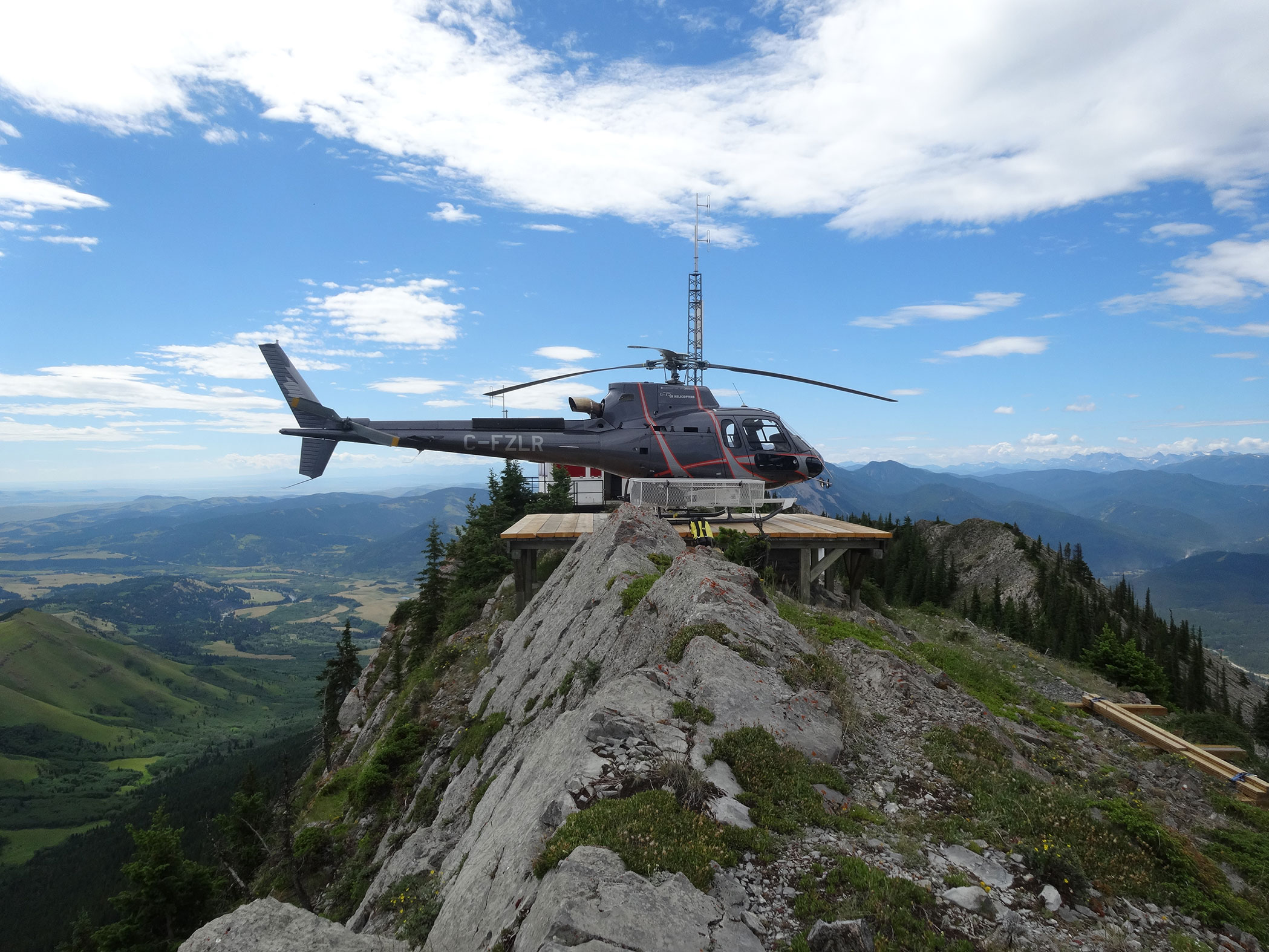 A helicopter flying over a mountain