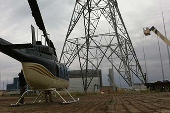 Helicopter aerial cleaning and de-icing for power lines and windmills Calgary Alberta Canada