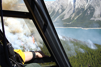 Helicopter CharterAdvanced Helicopter Forestry Proficiency Pilot Training Calgary Alberta Canada - Man in a helicopter