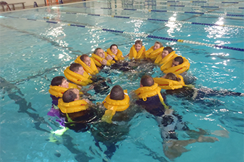 Initial-and-annual Helicopter Training. Students in a pool