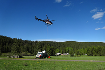 ertical Reference Pilot Training Calgary Alberta Canada - a helicopter flying doing a vertical reference flying