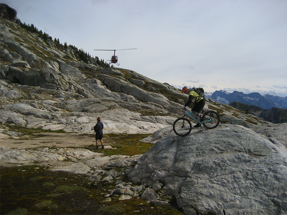 Helicopter Biking L R Helicopters inc - Helicopter bikers on top of a mountain