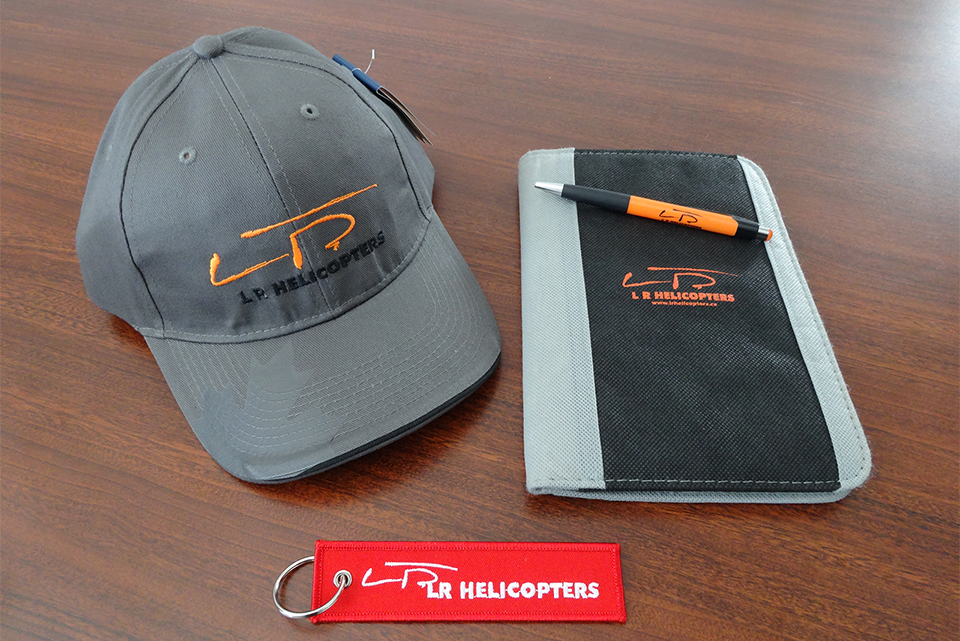 Calgary Helicopter Flight Gift Certificates - L R Helicopter Promotional items on a table
