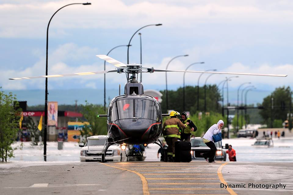 Floor rescue using a helicopter in High River flooding Canada