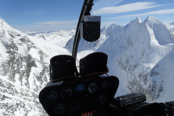 Avalanche Control - Helicopter flying over a mountain
