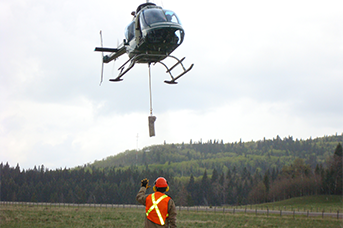 Helicopter Awareness Training - Helicopter landing guided by a person from a ground
