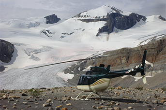 National Parks Management - a helicopter landing on top of a mountain